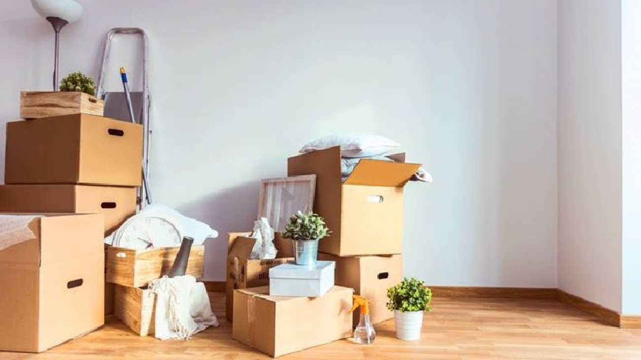 Move. Cardboard boxes and cleaning things for moving into a new home